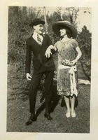 A Man and a Woman Posing Outdoors