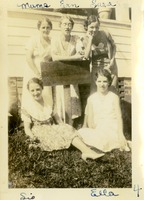 Five Women Posing Outside of a House