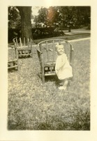 Baby Outdoors Next to a Lawn Chair