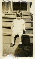 Young Boy Sitting on Steps