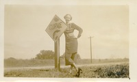 "Florence Gregory Posed by Road Sign Saying ""Curve"""
