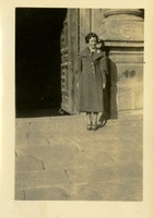 Woman Posed on Steps of a Building