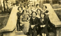 Group of Eleven Women Sitting on Steps