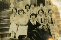 Group of Eight Women Sitting on Steps