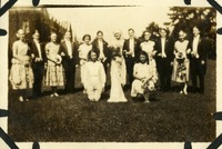 Group of Women in Formal Costume with Some Wearing Men's Clothing