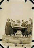 Seven Women Standing on Top of a Fountain