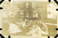 Group of Women Sitting on a Lawn