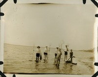 Group of People Holding Fishing Nets on a Beach in Saint Theresa