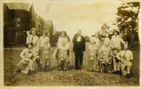 Group of Twelve Women Standing Outside in Costume