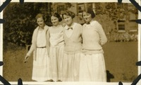 Four Women Standing Arm in Arm