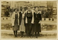 Four Women Standing in Front of Fountain