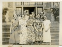 Group of Women Standing on Stairs in front of House