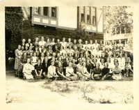 Large Group of Women in Front Lawn of House