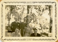 Five Men, a Woman, and a Child Posing in front of Trees
