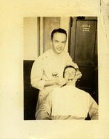 A Dentist Working on another Man's Mouth