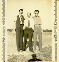 Three Men Standing Together