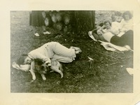 A Woman Lying Next to a Dog and Three Women in the Background