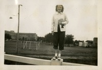 Marjorie Fogarty on Campus with Gymnasium in the Background