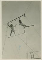 Sara Culbreth Cooper and Juanita Muller Performing a Stunt on the Trapeze