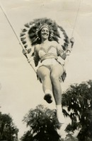 Sara Culbreth Cooper in a Headdress on a Cloud Swing