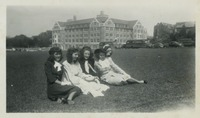 Female Students in Their Easter Dresses Relaxing on Landis Green