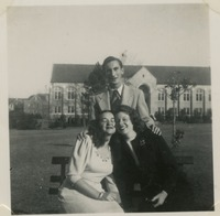 Three Students On a Bench In Front of Johnston Building