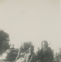 Three Students Sitting On a Wall On Campus