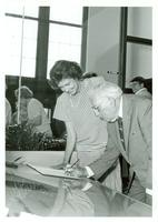 Claude Pepper signing a book with Florida First Lady Adele Graham at the Pepper Library dedication