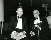 Bob Hope sitting with an elderly man at Claude Pepper's 84th birthday party