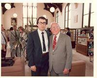 Claude Pepper posing with a man at the dedication of the Mildred and Claude Pepper Library
