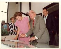 Claude Pepper signing a guest book at the dedication of the Mildred and Claude Pepper Library