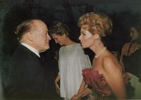 Bob Hope talking to a guest at Claude Pepper's 84th birthday party