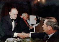 Bob Hope shaking hands with a guest at Claude Pepper's 84th birthday party