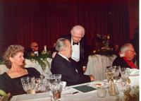 Anthony Quinn speaking to a guest at Claude Pepper's 84th birthday party