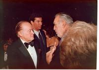 Bob Hope talking to Anthony Quinn at Claude Pepper's 84th birthday party
