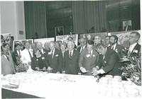 Various people lighting the candles on Claude Pepper's 85th birthday cake