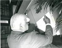 Tip O'Neill signing a guest book at the dedication of the Mildred and Claude Pepper Library