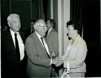 Claude Pepper shaking hands with a guest at the dedication of the Mildred and Claude Pepper Library