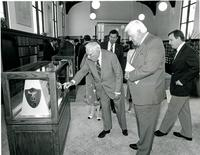 Claude Pepper pointing to a display at the dedication of the Mildred and Claude Pepper Library