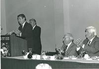 Don Fuqua speaking at a luncheon for Claude Pepper with Bernard Sliger and Tip O'Neill