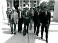 Claude Pepper walking with a group at the dedication of the Mildred and Claude Pepper Library