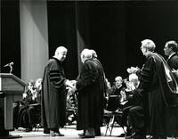 Claude Pepper shaking hands with Tip O'Neill at an Honorary Degree ceremony