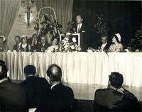 Arthur Courshon speaking at a luncheon following a bank dedication