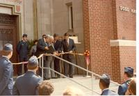 Claude Pepper cutting the ribbon at the dedication of the Claude and Mildred Pepper Library