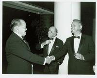 Bob Hope shaking hands with guests at Claude Pepper's 84th birthday party