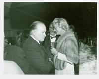 Bob Hope shaking hands with Claudette and Dick Hallam at Claude Pepper's 84th birthday party