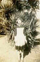 Perilie Hunt Standing In Front of a Palmetto