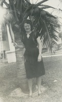 Faith James Standing In Front of a Palm Tree