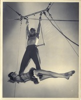 Man And Woman on the Single Trapeze