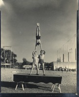 Three Men Perform a Balancing Act at the Circus Lot on Call Street